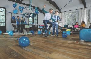 family playing on laminate flooring